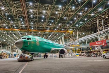1st 737 Built at 42-per-month Rate Rolls out of Renton Factory, March 2014